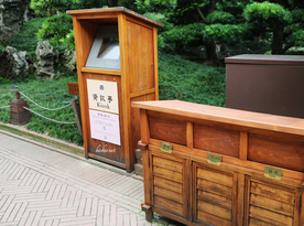 Nan Lian Gardens Hong Kong- Trash and information kiosk.